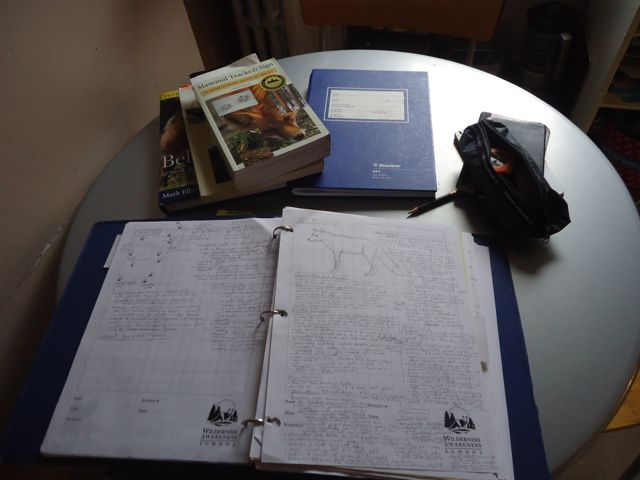 tracking binder on kitchen table